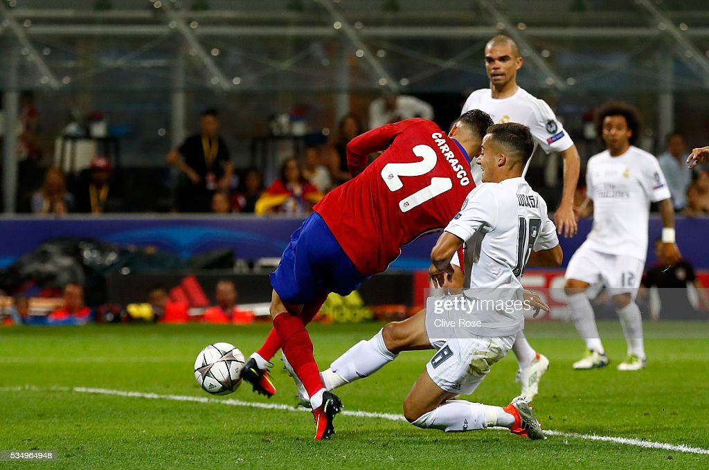 Yannick Carrasco of Atletico Madrid beats Lucas Vazquez of Real Madrid to the ball to score the equalising goal during the UEFA Champions League Final match between Real Madrid and Club Atletico de Madrid at Stadio Giuseppe Meazza on May 28, 2016 in Milan, Italy.