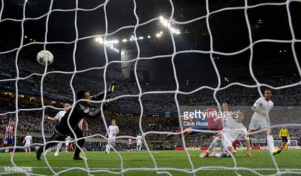Yannick Carrasco of Atletico Madrid beats Lucas Vazquez of Real Madrid to the ball to score the equalising goal during the UEFA Champions League...
