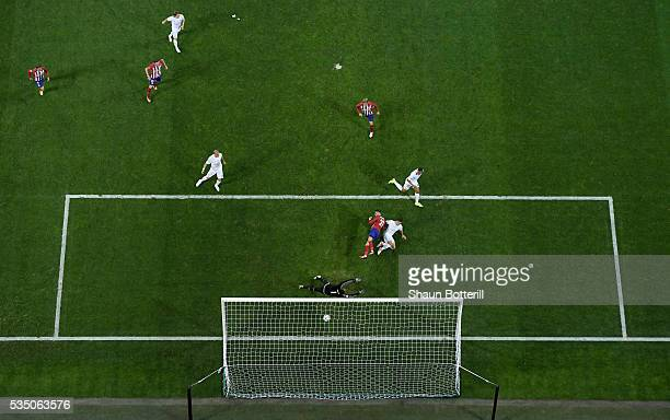 Yannick Carrasco of Atletico Madrid beats Lucas Vazquez of Real Madrid to the ball to score the equalising goal past Keylor Navas of Real Madrid...