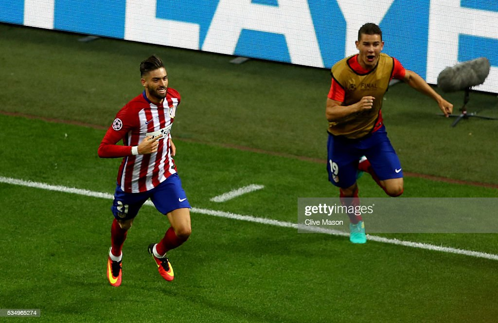Yannick Carrasco of Atletico Madrid celebrates afte scorig the equalizing goal during the UEFA Champions League Final match between Real Madrid and Club Atletico de Madrid at Stadio Giuseppe Meazza on May 28, 2016 in Milan, Italy.