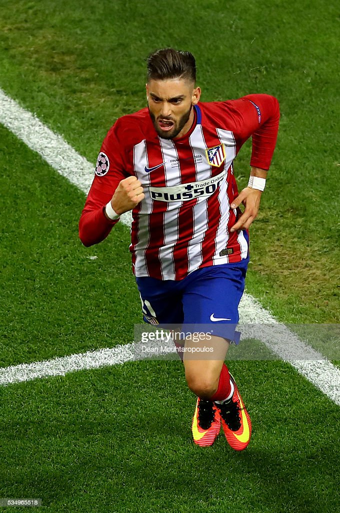 Yannick Carrasco of Atletico Madrid celebrates afte scorig the equalizer during the UEFA Champions League Final match between Real Madrid and Club Atletico de Madrid at Stadio Giuseppe Meazza on May 28, 2016 in Milan, Italy.