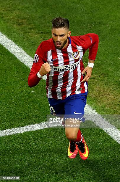 Yannick Carrasco of Atletico Madrid celebrates afte scorig the equalizer during the UEFA Champions League Final match between Real Madrid and Club...
