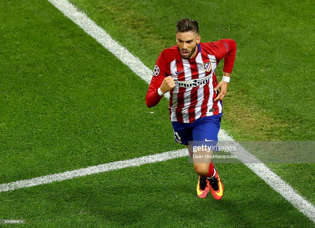 Yannick Carrasco of Atletico Madrid celebrates after scoring the equalising goal during the UEFA Champions League Final match between Real Madrid and Club Atletico de Madrid at Stadio Giuseppe Meazza on May 28, 2016 in Milan, Italy.