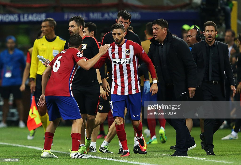 Yannick Carrasco (C) of Atletico Madrid celebrates scoring his team's first goal with his team mates and staffs during the UEFA Champions League Final between Real Madrid and Club Atletico de Madrid at Stadio Giuseppe Meazza on May 28, 2016 in Milan, Italy.