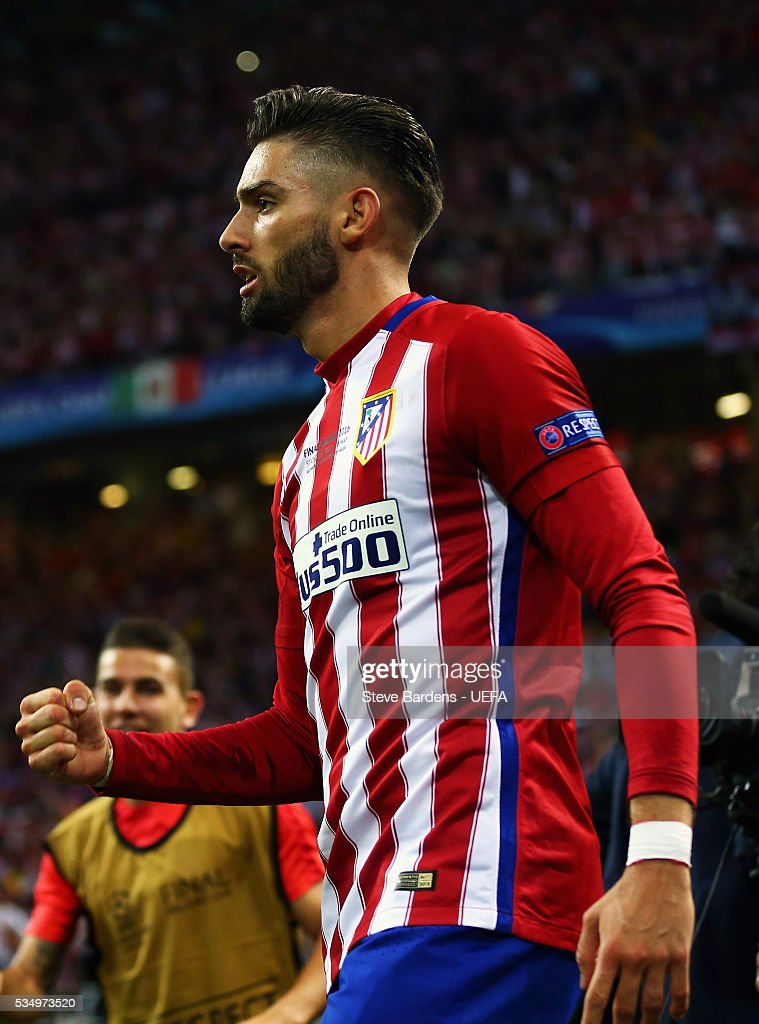 Yannick Carrasco of Atletico Madrid celebrates scoring his team's first goal during the UEFA Champions League Final between Real Madrid and Club Atletico de Madrid at Stadio Giuseppe Meazza on May 28, 2016 in Milan, Italy..