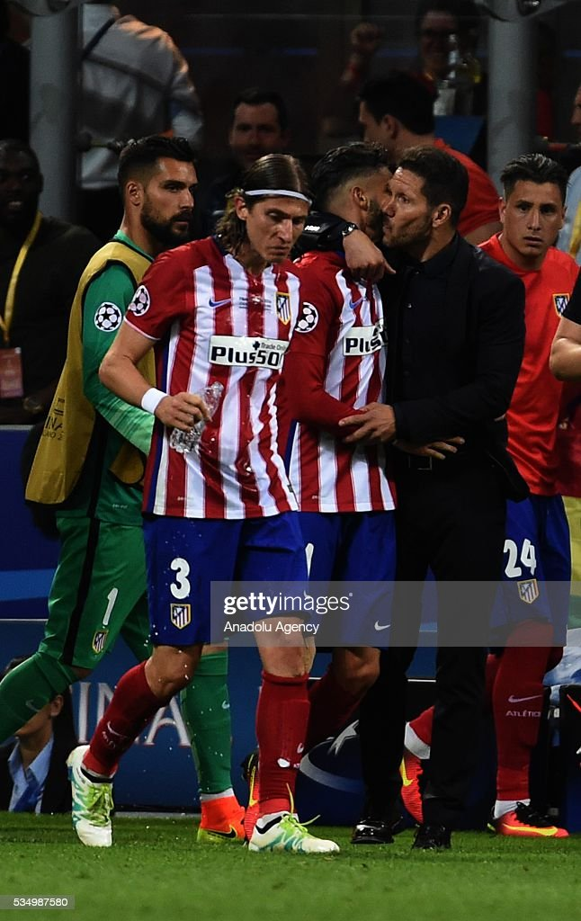 Yannick Carrasco of Atletico Madrid celebrates with Diego Simeone his goal scores a goal during the UEFA Champions League Final between Real Madrid CF and Atletico Madrid at the Giuseppe Meazza Stadium in Milan, Italy on May 28, 2016.