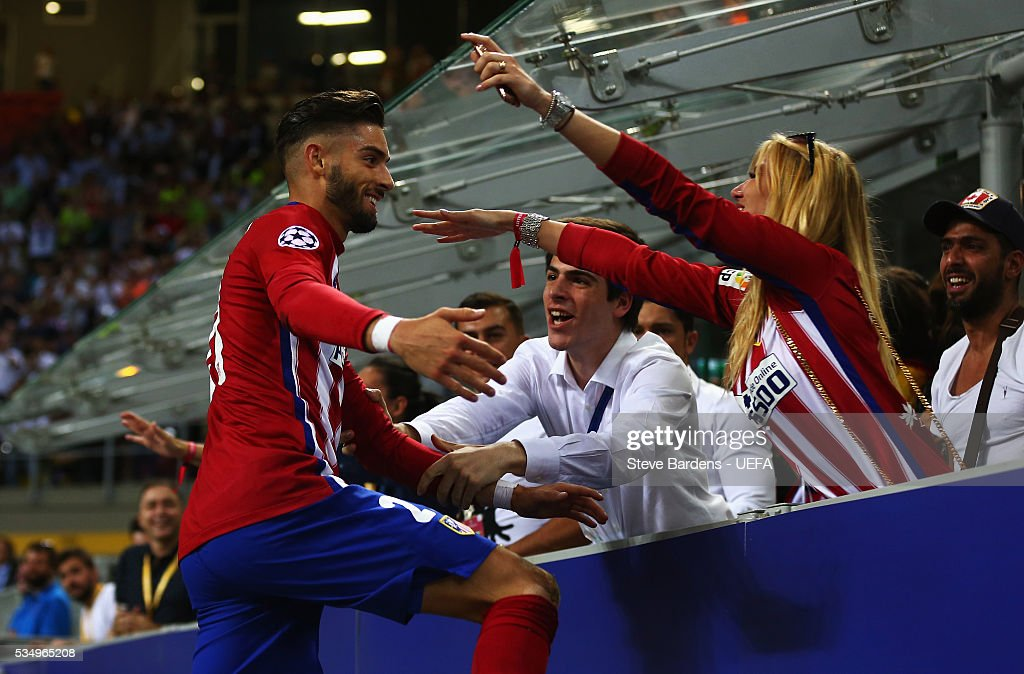 Yannick Carrasco of Atletico Madrid celebrates with a member of the crowd during the UEFA Champions League Final between Real Madrid and Club Atletico de Madrid at Stadio Giuseppe Meazza on May 28, 2016 in Milan, Italy.