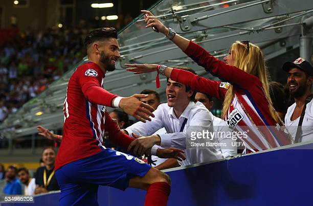 Yannick Carrasco of Atletico Madrid celebrates with his girlfriend in the crowd during the UEFA Champions League Final between Real Madrid and Club...