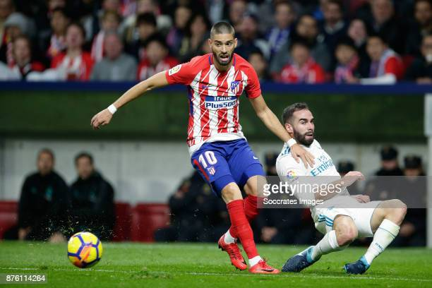 Yannick Carrasco of Atletico Madrid Dani Carvajal of Real Madrid during the Spanish Primera Division match between Atletico Madrid v Real Madrid at...