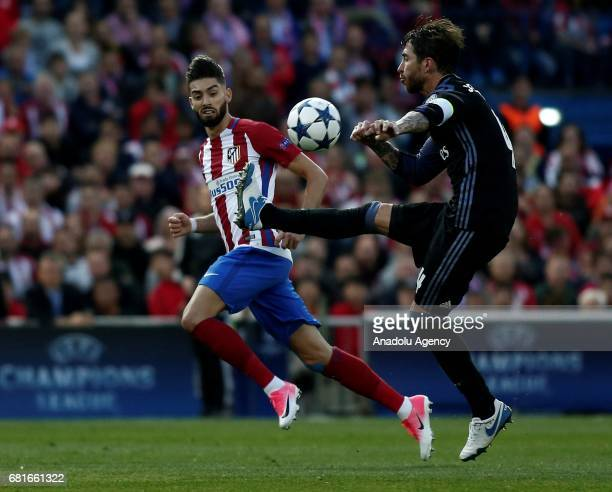 Yannick Carrasco of Atletico Madrid in action against Sergio Ramos of Real Madrid during the UEFA Champions League semi final second leg match...