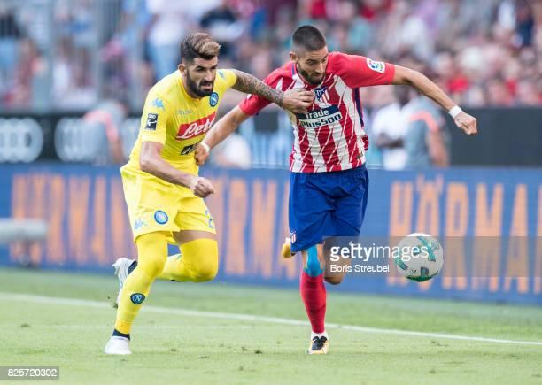 Yannick Carrasco of Atletico Madrid is challenged by Elseid Hysaj of SSC Napoli during the Audi Cup 2017 match between Club Atletico de Madrid and...