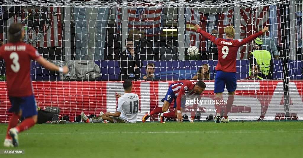 Yannick Carrasco of Atletico Madrid scores a goal during the UEFA Champions League Final between Real Madrid CF and Atletico Madrid at the Giuseppe Meazza Stadium in Milan, Italy on May 28, 2016.