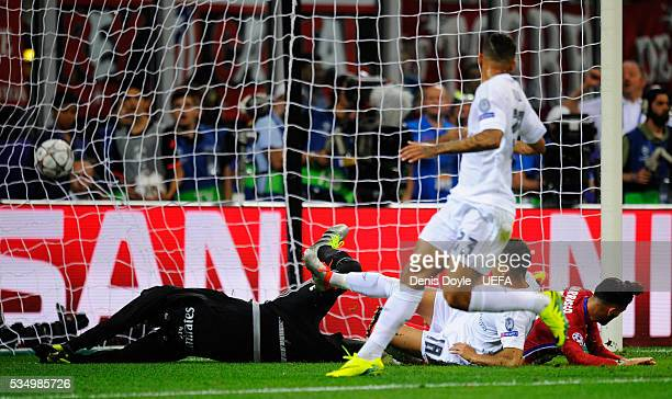 Yannick Carrasco of Atletico Madrid scores his team's first goal during the UEFA Champions League Final between Real Madrid and Club Atletico de...