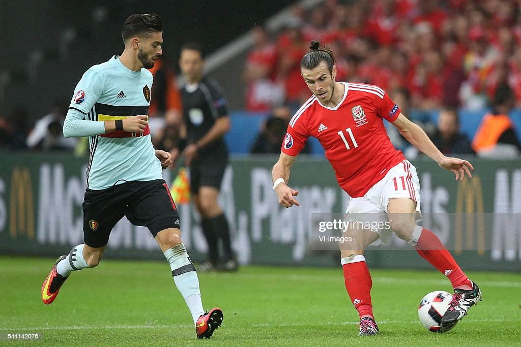 Yannick Carrasco of Belgium, Gareth Bale of Wales during the UEFA EURO 2016 quarter final match between Wales and Belgium on July 2, 2016 at the Stade Pierre Mauroy in Lille, France.