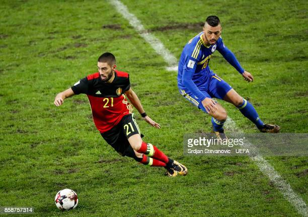 Yannick Carrasco of Belgium in action against Haris Medunjanin of Bosnia during the FIFA 2018 World Cup Qualifier between Bosnia and Herzegovina and...
