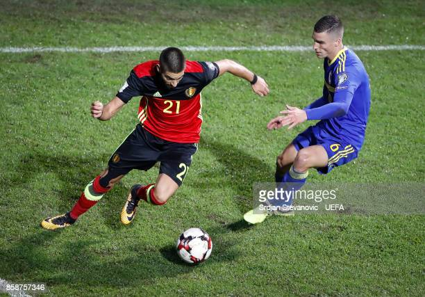 Yannick Carrasco of Belgium in action against Ognjen Vranjes of Bosnia during the FIFA 2018 World Cup Qualifier between Bosnia and Herzegovina and...