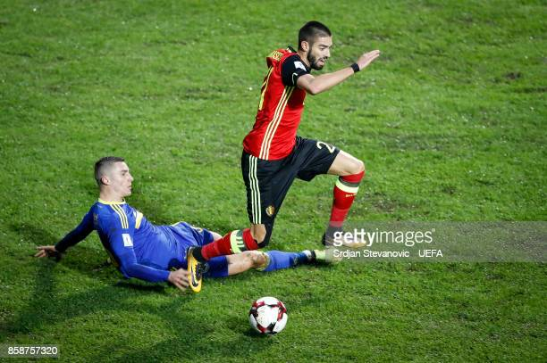 Yannick Carrasco of Belgium is challenged by Ognjen Vranjes of Bosnia during the FIFA 2018 World Cup Qualifier between Bosnia and Herzegovina and...