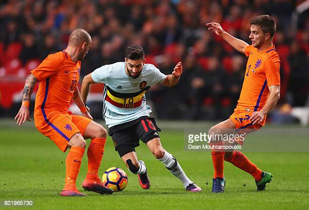 Yannick Carrasco of Belgium takes on Wesley Sneijder and Joel Veltman of the Netherlands during the international friendly match between Netherlands...