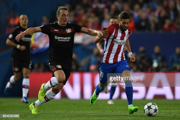 Yannick Carrasco of Club Atletico de Madrid and Julian Baumgartlinger of Bayer Leverkusen compete for the ball during the UEFA Champions League Round...