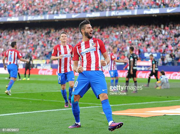 Yannick Carrasco of Club Atletico de Madrid celebrates after scoring his team's opning goal during the La Liga match between Club Atletico de Madrid...