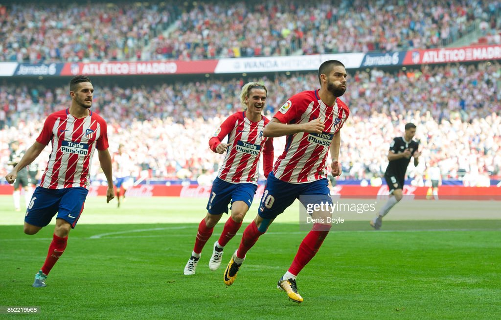 Yannick Carrasco of Club Atletico de Madrid celebrates after scoring his sides 1st goal during the La Liga match between Atletico Madrid and Sevilla at Wanda Metropolitano on September 23, 2017 in Madrid, Spain.