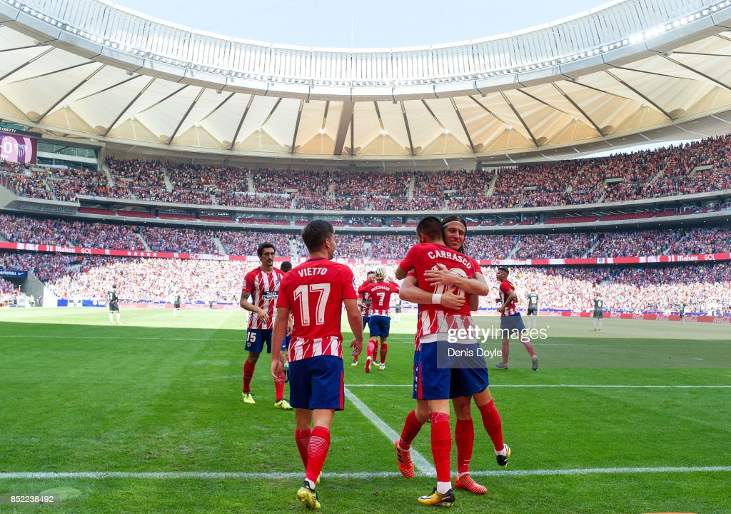 Yannick Carrasco of Club Atletico de Madrid celebrates with Felipe Luis after scoring his team's opening goal during the La Liga match between Atletico Madrid and Sevilla at Wanda Metropolitano on September 23, 2017 in Madrid, Spain.