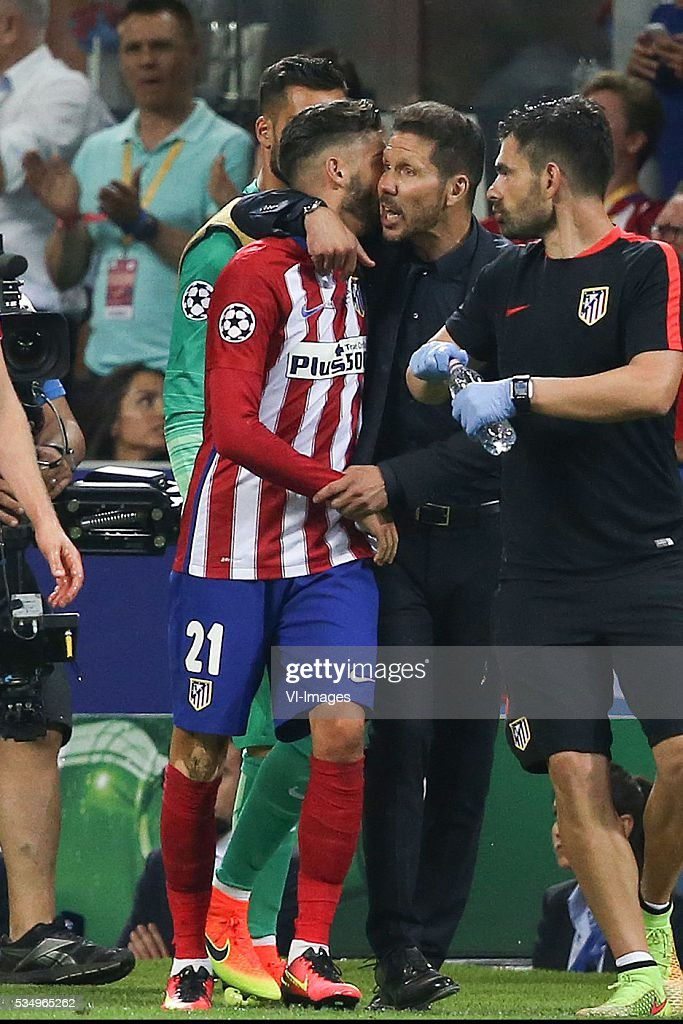 Yannick Carrasco of Club Atletico de Madrid, coach Diego Simeone of Club Atletico de Madrid during the UEFA Champions League final match between Real Madrid and Atletico Madrid on May 28, 2016 at the Giuseppe Meazza San Siro stadium in Milan, Italy.