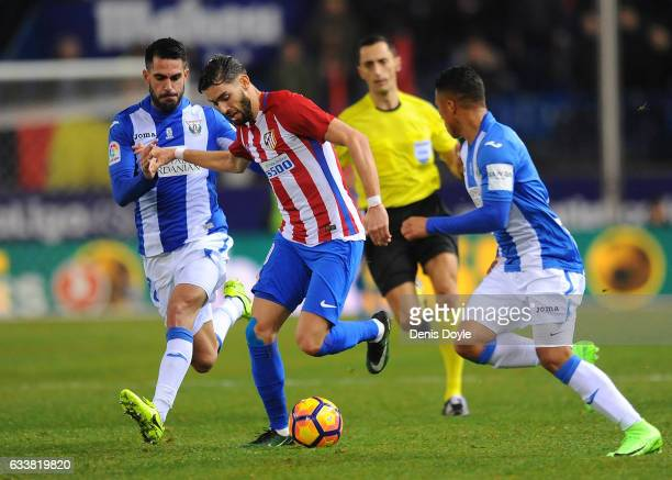Yannick Carrasco of Club Atletico de Madrid is chased by Pablo Insua of CD Leganes during the La Liga match between Club Atletico de Madrid and CD...