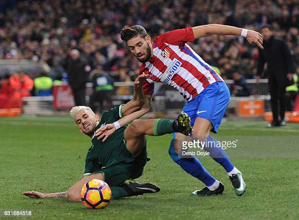Yannick Carrasco of Club Atletico de Madrid is tackled by Dani Ceballos of Real Betis Balompie during the La Liga match between Club Atletico de...