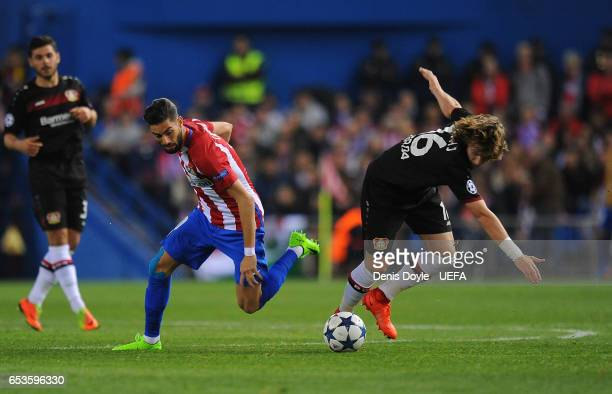 Yannick Carrasco of Club Atletico de Madrid is tackled by Tin Jedvaj of Bayer Leverkusen during the UEFA Champions League Round of 16 second leg...