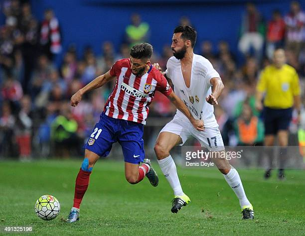 Yannick Carrasco of Club Atletico de Madrid outpaces Alvaro Arbeloa of Real Madrid during the La Liga match between Club Atletico de Madrid and Real...
