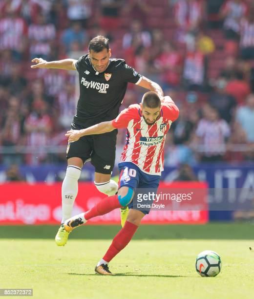 Yannick Carrasco of Club Atletico de Madrid shakes off Gabriel Mercado of Sevilla FC during the La Liga match between Atletico Madrid and Sevilla at...