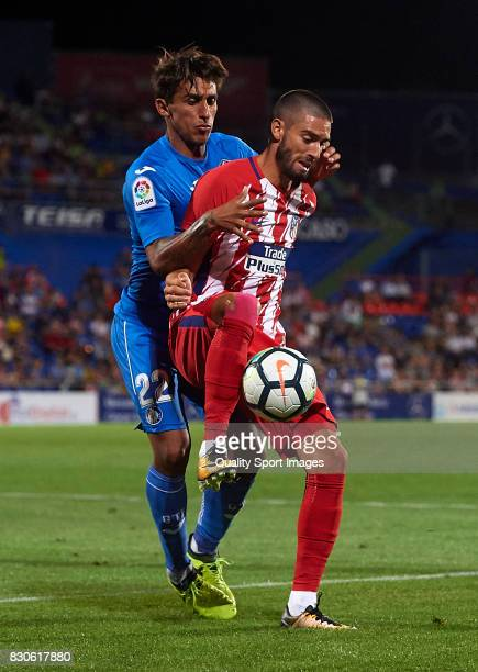 Yannick Carrasco of Getafe is challenged by Damian Suarez of Atletico de Madrid during the Pre Season Friendly match between Getafe CF and Atletico...