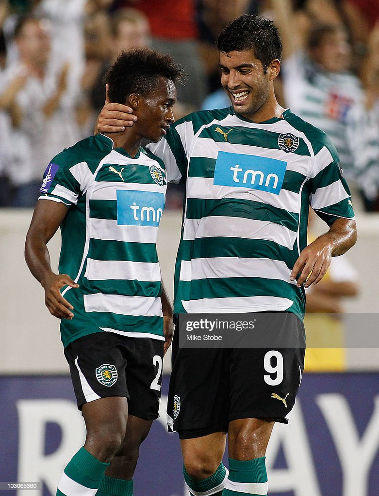 <a gi-track='captionPersonalityLinkClicked' href=/galleries/search?phrase=Yannick+Djalo&family=editorial&specificpeople=3684315 ng-click='$event.stopPropagation()'>Yannick Djalo</a> #20 of Sporting Lisbon celebrates his goal in the 23rd minute with teammate Carlos Saleiro #9 against Manchester City in the Barclays New York Challenge July 23, 2010 at Red Bull Arena in Harrison, New Jersey. Sporting Lisbon won 2-0.