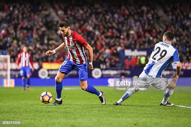 Yannick Ferreira Carrasco of Atletico de Madrid battles for the ball with Aaron Martin of RCD Espanyol during the La Liga match between Atletico de...