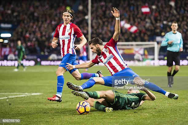 Yannick Ferreira Carrasco of Atletico de Madrid battles for the ball with Daniel Ceballos Fernandez 'Dani Ceballos' of Real Betis Balompie during...