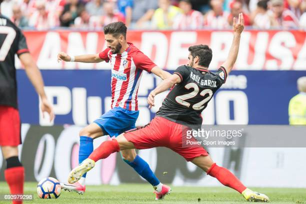 Yannick Ferreira Carrasco of Atletico de Madrid battles for the ball with Raul Garcia of Athletic Club during the La Liga match between Atletico de...