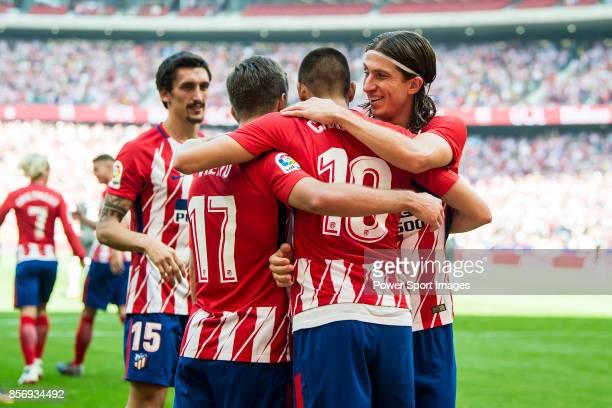 Yannick Ferreira Carrasco of Atletico de Madrid celebrates with teammates Filipe Luis and Luciano Vietto during the La Liga 201718 match between...