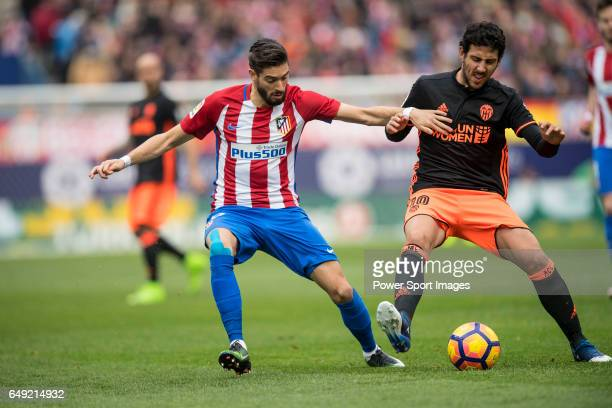 Yannick Ferreira Carrasco of Atletico de Madrid competes for the ball with Daniel Parejo Munoz of Valencia CF during the match Atletico de Madrid vs...