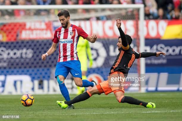 Yannick Ferreira Carrasco of Atletico de Madrid competes for the ball with Enzo Nicolas Perez of Valencia CF during the match Atletico de Madrid vs...