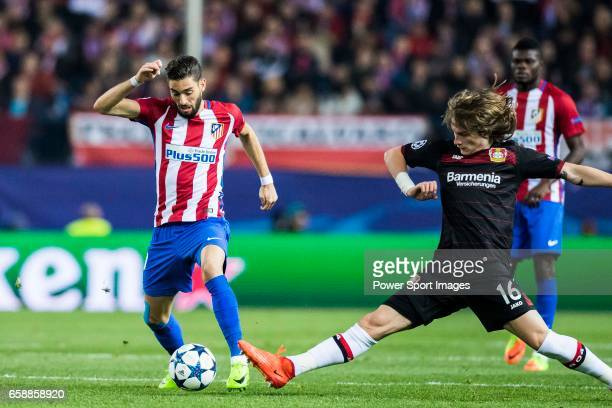 Yannick Ferreira Carrasco of Atletico de Madrid fights for the ball with Tin Jedvaj of Bayer 04 Leverkusen during their 201617 UEFA Champions League...