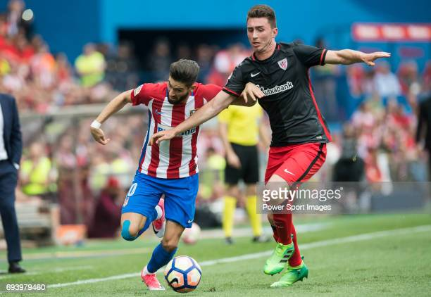 Yannick Ferreira Carrasco of Atletico de Madrid fights for the ball with Aymeric Laporte of Athletic Club during the La Liga match between Atletico...