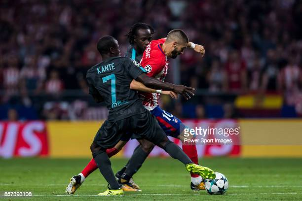 Yannick Ferreira Carrasco of Atletico de Madrid fights for the ball with N'Golo Kante and Victor Moses of Chelsea FC during the UEFA Champions League...