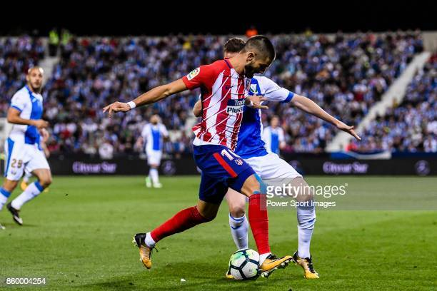 Yannick Ferreira Carrasco of Atletico de Madrid fights for the ball with Javier Eraso Goni of CD Leganes during the La Liga 201718 match between CD...