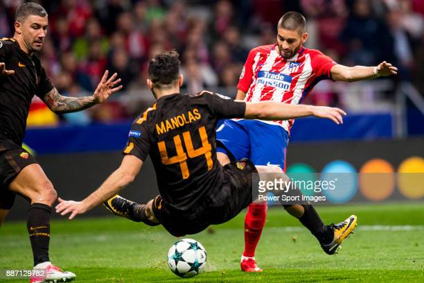 Yannick Ferreira Carrasco of Atletico de Madrid flighs the ball with Kostas Manolas of AS Roma during the UEFA Champions League 201718 match between...