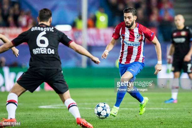 Yannick Ferreira Carrasco of Atletico de Madrid is challenged by Aleksandar Dragovic of Bayer 04 Leverkusen during their 201617 UEFA Champions League...