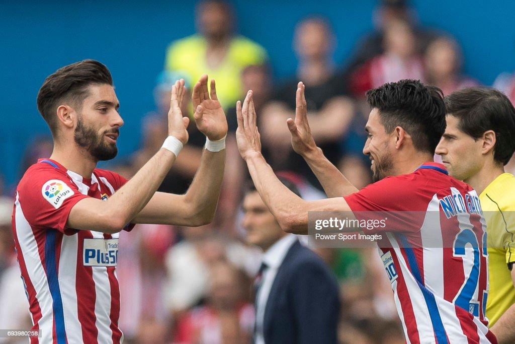 Yannick Ferreira Carrasco (L) of Atletico de Madrid reacts with Nicolas Gaitan (R) of Atletico de Madrid during the La Liga match between Atletico de Madrid and Athletic de Bilbao at the Estadio Vicente Calderon on 21 May 2017 in Madrid, Spain.