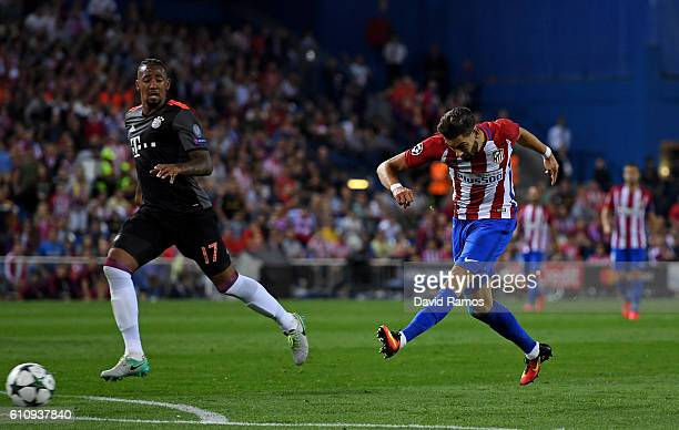Yannick Ferreira Carrasco of Atletico Madrid scores the opening goal during the UEFA Champions League group D match between Club Atletico de Madrid...