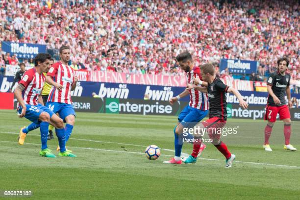 Yannick Ferreira Carrasco try to stop Iker Muniain during the football match between Atletico de Madrid and Athletic de Bilbao Atletico de Madrid win...
