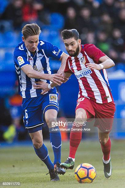Yannick FerreiraCarrasco of Atletico Madrid duels for the ball with Marcos Llorente of Deportivo Alaves during the La Liga match between Deportivo...